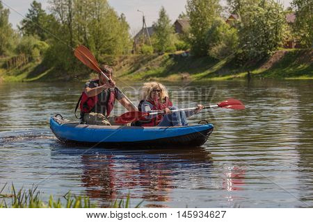 Sport couple is kayaking on the river