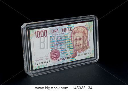 Old 1000 lire. Italian banknote on black background