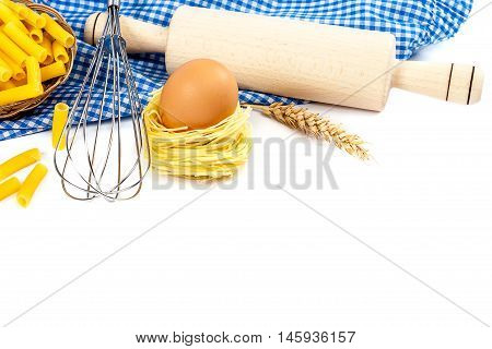 Kitchen utensils eggs and flour for baking isolated on white background.