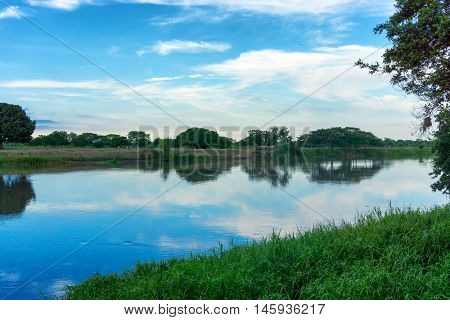 View of the Magdalena River with a beautiful reflection in Mompox Colombia