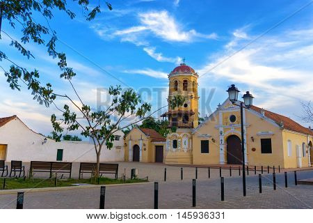 View of the yellow Santa Barbara church in Mompox Colombia