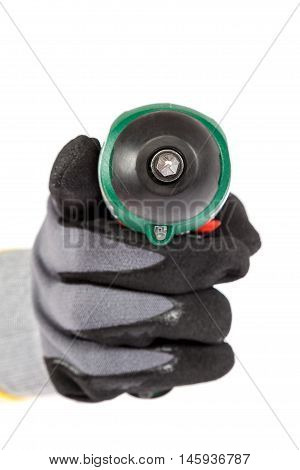 Independent electric screwdriver in a hand with work gloves isolated on a white background.