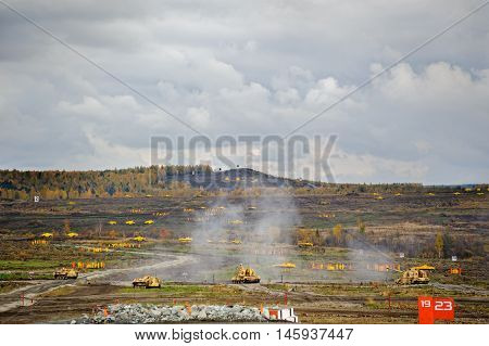 Nizhniy Tagil, Russia - September 26. 2013: Platoon from T-90S and Tank assistance combat vehicle BMPT attack. Display of fighting opportunities of arms and military equipment. RAE-2013 exhibition
