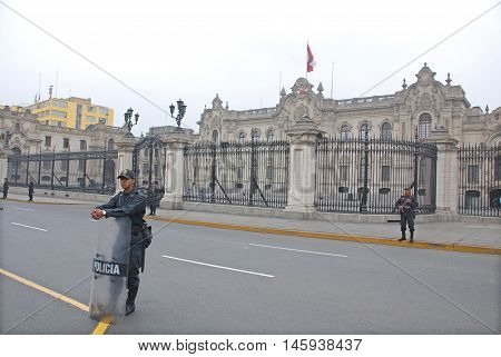 LIMA PERU NOV. 24 2009: Police in front the Government palace at Plaza de Armas, Peru.Is the birthplace of the city of Lima, as well as the core of the city. Located in the Historic Centre of Lima.
