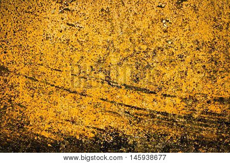 Full frame weathered and scratched gold patina background in horizontal 3:2 format.