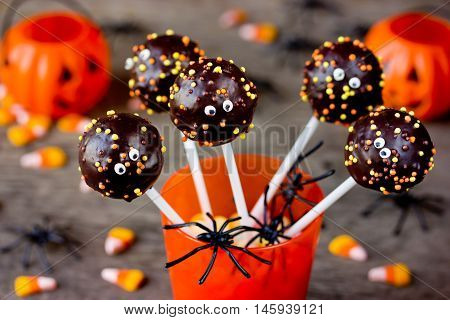 Halloween gourmet cake pops with holiday decor selective focus