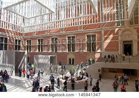 AMSTERDAM, NETHERLANDS - MAY 4, 2016: Hall interior of the national museum Rijksmuseum, Amsterdam, Netherlands. It is located at the Museum Square close to the Van Gogh Museum.