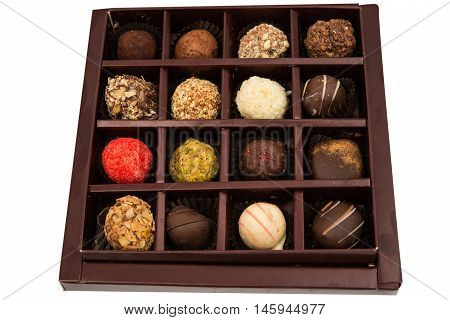 Boxes of chocolates truffles on a white background