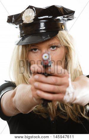blonde female policewoman cop posing with gun handgun isolated on white background