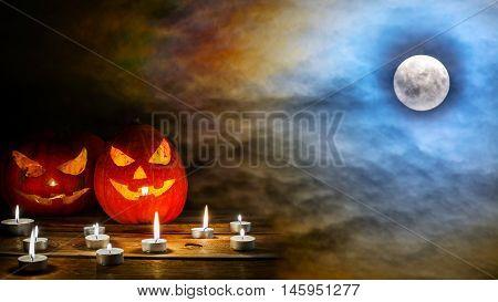 Halloween jack-o-lantern on the terrifying midnight sky with full moon background. Halloween symbol smiling pumpkin background.