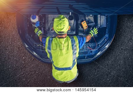 Car Mechanic Servicing Vehicle. Broken Modern Car with Open Hood. Car Repair.