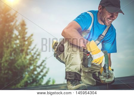 Happy Construction Worker Smiling While Working on Wooden Roof. Satisfied Worker.