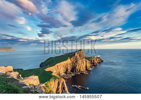Colorful Sunset Clouds over Neist Point Lighthouse Popular Location on the Isle of Skye in Scotland