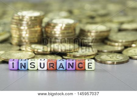 Close up Insurance text on colorful dice