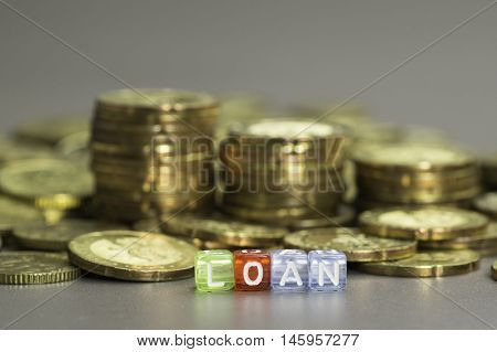 Close up Loan text on colorful dices
