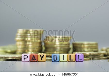 Close up Pay bill text on colorful dice