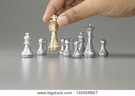 Hand Holding The Golden Queen Chess
