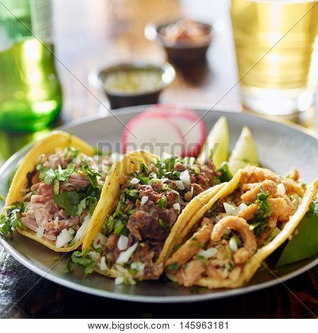 authentic mexican street tacos on plate with beef and pork