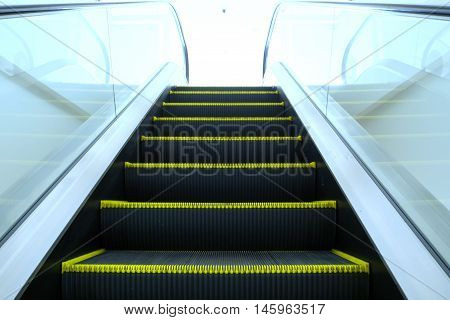 Look up the escalator from the ground below in superstore