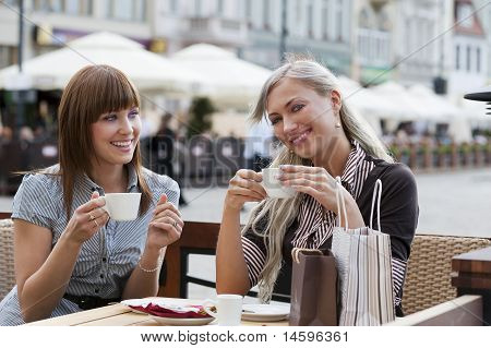 Smiling Girl Drinking A Coffee
