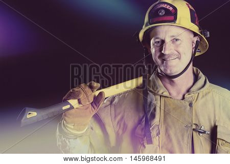 Smiling firefighter man holding axe