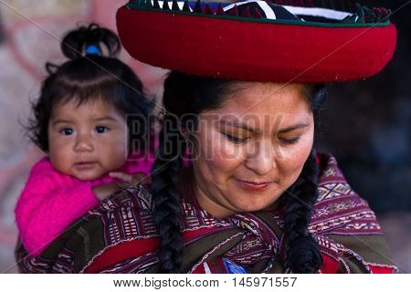 Close Up Of A Native Peruvian Mother And Her Baby Girl
