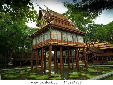 the wooden scripture tower of Thai Buddhist temple