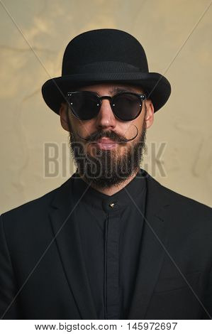 Gentleman with Bowler Hat and elegant black Suit