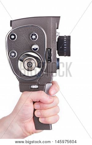 Retro Movie Camera In Hands Of Operator Isolated