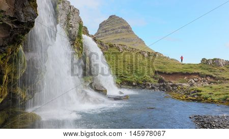 Kirkjufellsfoss Waterfall Near The Kirkjufell Mountain, Unrecognisable Woman