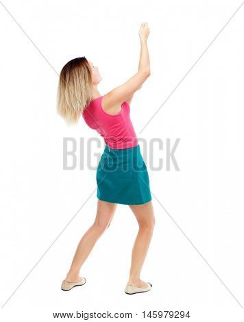 back view of standing girl pulling a rope from the top or cling to something. Isolated over white background. Blonde in a red sweater and green skirt drawn above.