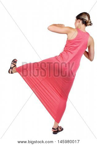 skinny woman funny fights waving his arms and legs. slender woman in a long red dress with a sweep has foot.