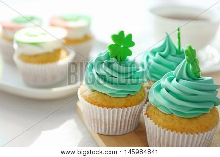 Tasty cupcakes on table. Saint Patrics Day concept