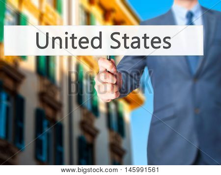 United States - Businessman Hand Holding Sign