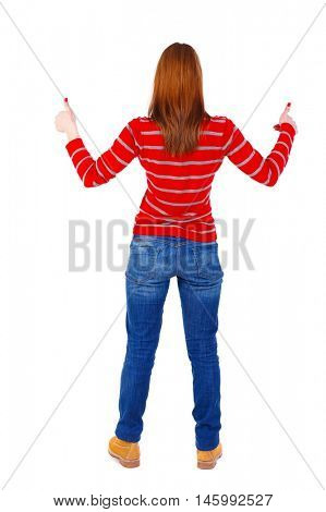 Back view of woman thumbs up. blonde in a red striped sweater is holding up both hands thumbs up.
