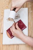 leathercrafting - craftsman corrects stamping of handmade leather pouch poster