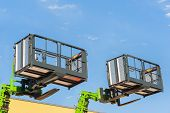 Forklift telescopic boom with buckets and aerial working platform. poster