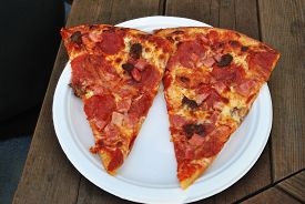 Meaty Pizza Served on a Paper Plate