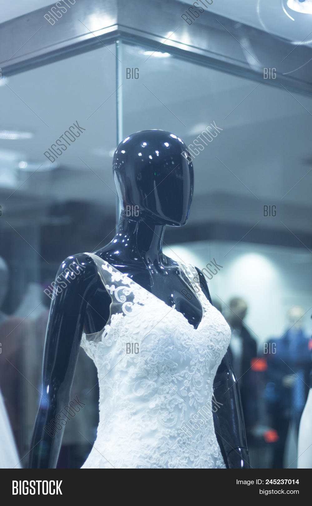 b192883ce347 Bridal shop dummy bride mannequin in department store with white wedding  dress.
