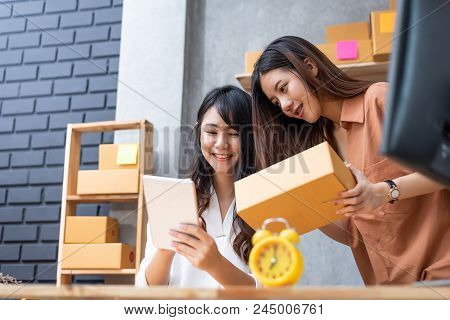 Two Young Asian Women Startup Small Business Entrepreneur Sme Distribution Warehouse With Parcel Mai