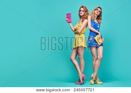 Full-length Portrait Two Young Woman In Fashion Pose. Trendy Floral Dress, Wavy Hairstyle. Glamour S