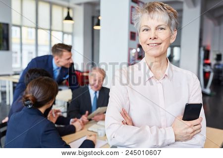 Senior businesswoman as self confident and successful manager