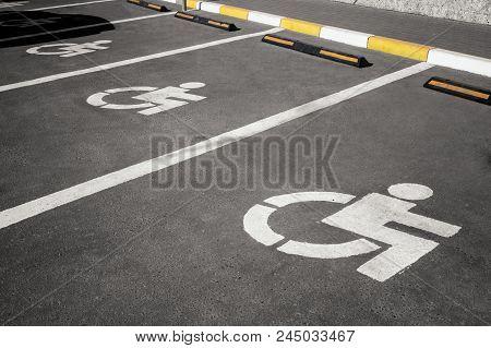Handicap Parking In A Row, Wheelchair Parking Symbole On Asphalt Road