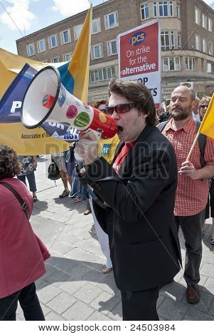 A call through the megaphone during the June 30 national striker rally through Exeter City Centre.