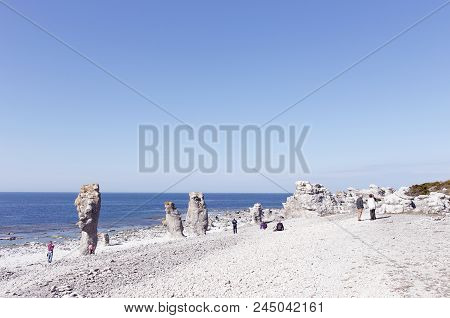 Faro, Sweden - May 13, 2016: People At The Sea Stacks Located At Langshammars In The Swedish Provinc
