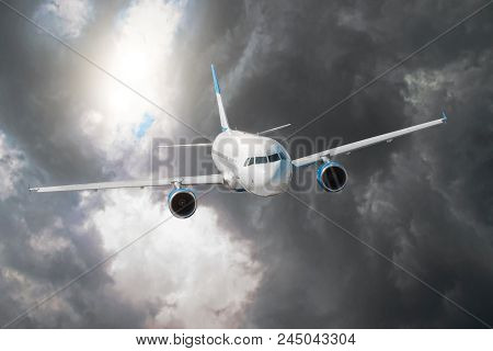 Passenger airplane flies through the turbulence zone through the lightning of storm clouds in bad weather poster