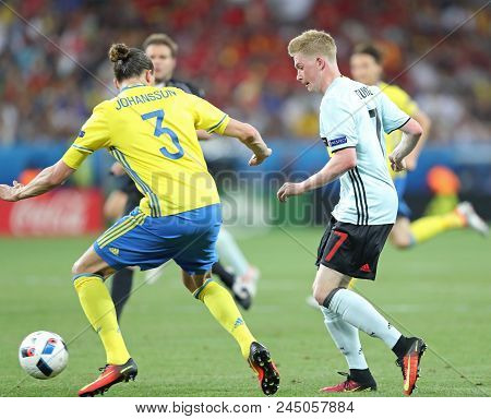Nice, France - June 22, 2016: Kevin De Bruyne Of Belgium (r) Fights For A Ball With Erik Johansson O
