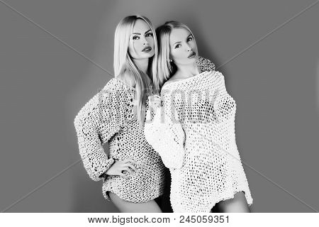 Female Fashion And Beauty. Twins. Two Pretty Girls Or Cute Women Twins, Fashionable Models With Blon