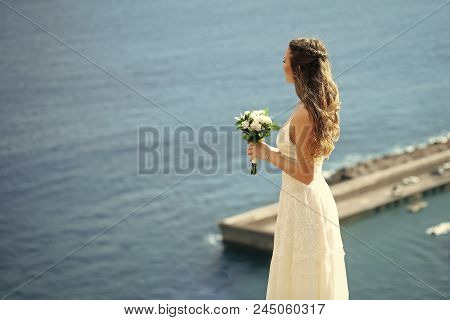 Wedding Chores. Pretty Girl Or Beautiful Bride, Young, Sexy Woman In White Dress With Wedding Bouque