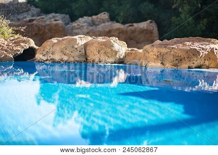 Outdoor Inground Residential Swimming Pool In Backyard With Hot Tub. Water. Relax. Recreation